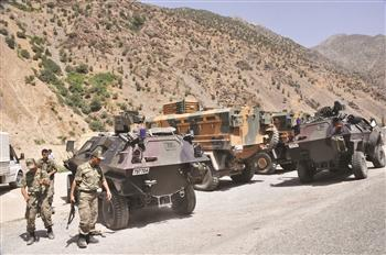 The Turkish military deploys a number of tanks and other vehicles around a military post, which has been attacked by the outlawed PKK militants in Hakkari's Çukurca district. Nearly 130 militants were killed in the ongoing operations, a minister says. DHA photo