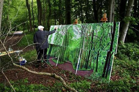 David Hockney while working on his canvas