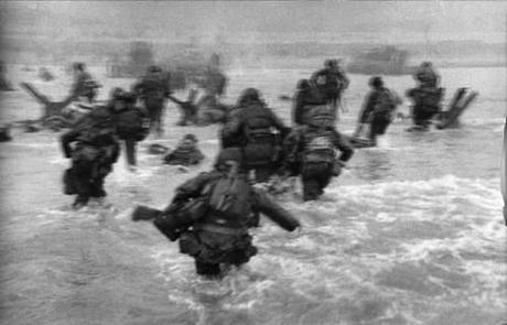 R. Capa, Normandy. Omaha Beach. The first wave of American troops lands at dawn. June 6th, 1944