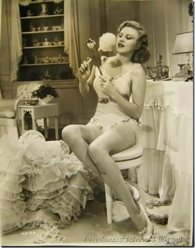 Ginger Rogers powdering her face