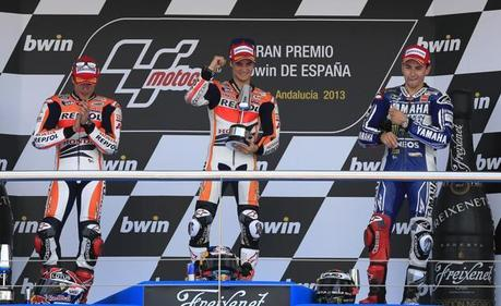Honda MotoGP rider Pedrosa of Spain celebrates on podium between Honda's rider Marquez of Spain and Yamaha's rider Lorenzo of Spain after winning the Spanish Grand Prix in Jerez de la Frontera