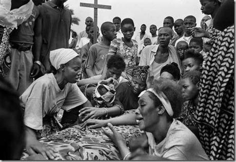 photo by Kadir van Lohuizen / NOOR  Diamond matters 2004 Funeral of a miner. Many miners die, because they drown or sand walls collapse, Mbuij Mayi, DR Congo