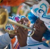Man playing a trumpet for the Junkanoo festivities in The Bahamas