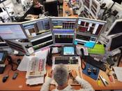 trader lunch front computers screens August 2011 office French investment company Aurel Paris. Global stocks tumbled further safe gold surged records mounting fears fresh g...
