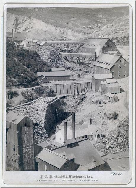 Title: Mines and Mills. The Caledonia No. 1, Deadwood Terra No. 2, and Terra No. 3. Gold Stamp Mills, located at Terraville, Dak. Three prominent lumber mills and stacks of lumber. 1888. Repository: Library of Congress Prints and Photographs Division Washington, D.C. 20540