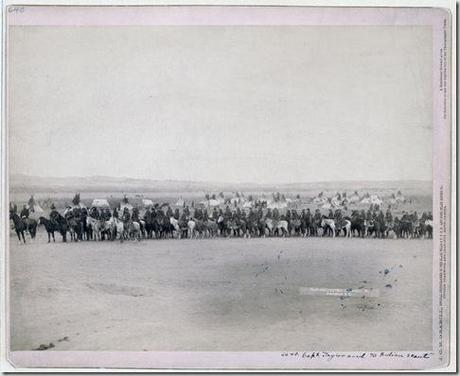 Title: Capt. Taylor and 70 Indian scouts Long row of military men and Lakota scouts on horseback in front of tipi camp--probably on or near Pine Ridge Reservation. 1891. Repository: Library of Congress Prints and Photographs Division Washington, D.C. 20540
