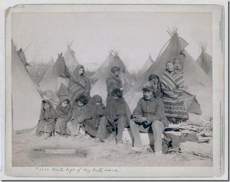 Title: What's left of Big Foot's band Group of eleven Miniconjou (children and adults) in a tipi camp, probably on or near Pine Ridge Reservation. 1891. Repository: Library of Congress Prints and Photographs Division Washington, D.C. 20540 USA