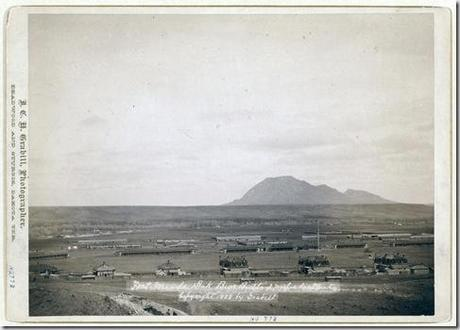 Title: Fort Meade, Dakota. Bear Butte, 3 miles distant Bird's-eye view of military camp buildings; butte in background. 1888. Repository: Library of Congress Prints and Photographs Division Washington, D.C. 20540