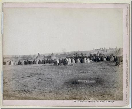 Title: Indian Council in Hostile Camp Rear view of a large semi-circle of Lakota men sitting on the ground, with tipis in background, probably on or near Pine Ridge Reservation. 1891. Repository: Library of Congress Prints and Photographs Division Washington, D.C. 20540