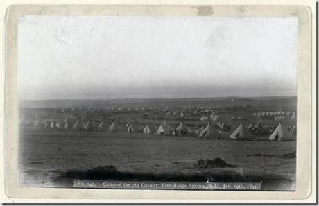 Title: Camp of the 7th Cavalry, Pine Ridge Agency, S.D., Jan. 19, 1891 View of military camp: tents, horses, and wagons. Repository: Library of Congress Prints and Photographs Division Washington, D.C. 20540