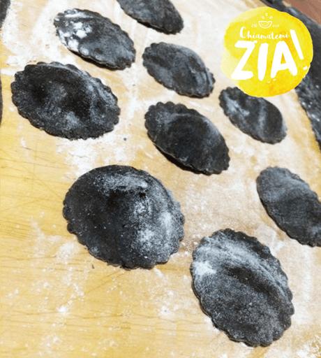 Ravioli al nero di seppia con spuma di mortadella