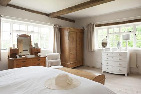 The double-aspect master bedroom looks out over the gardens, which have been a labour of love for Tara and Mark