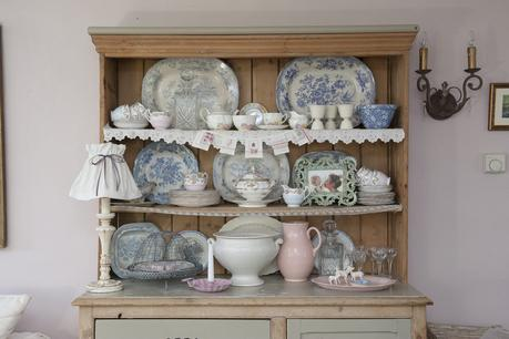A collection of pretty crockery on a farmhouse dresser completes the look in the living room