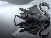 lago dove animali trasformano statue