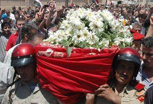 The funeral of a Syrian police officer killed in clashes at Homs