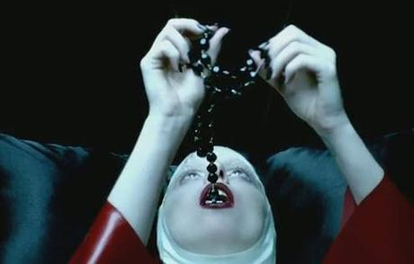 http://www.projectinspired.com/wp-content/uploads/lady-gaga-swallows-rosary.jpg