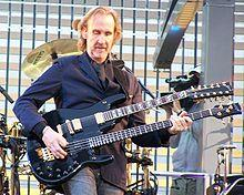 http://upload.wikimedia.org/wikipedia/commons/thumb/2/2e/Mike_Rutherford.jpg/220px-Mike_Rutherford.jpg