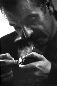 http://upload.wikimedia.org/wikipedia/commons/3/3a/Georges_Brassens_%281964%29_by_Erling_Mandelmann_-_2.jpg