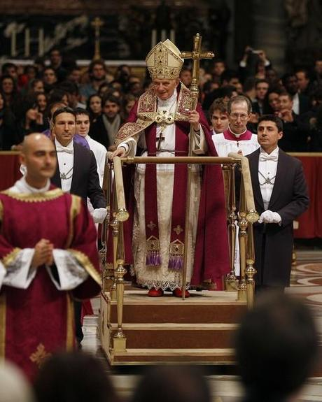 Pope Benedict XVI leaves at the end of a Vesper prayer in St. Peter's Basilica at the Vatican December 15, 2011.