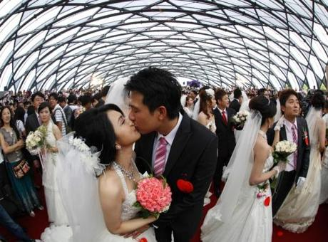 A couple kisses during a mass wedding ceremony at the Taipei Flora Expo Hall in Taiwan