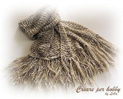 ... un filato di lino e seta piuttosto sottile e dei ferri da lana n. 4,5